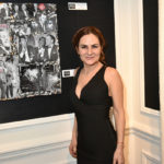 PARIS, FRANCE - DECEMBER 07:  Painter Anne Mondy (daughter of actor Pierre Mondy) poses with her work during the 'Accords Croises' Anne Mondy Exhibition Preview at Galerie Dedar on December 7, 2015 in Paris, France.  (Photo by Foc Kan/WireImage)